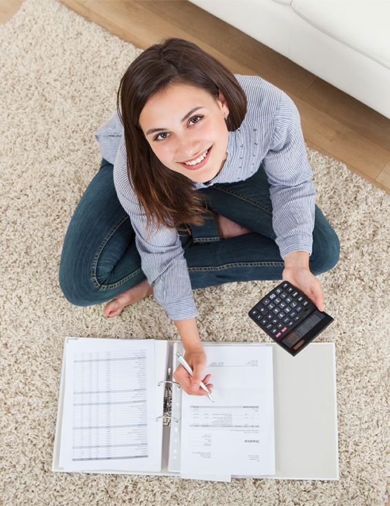 Young Girl With Calculator Planning